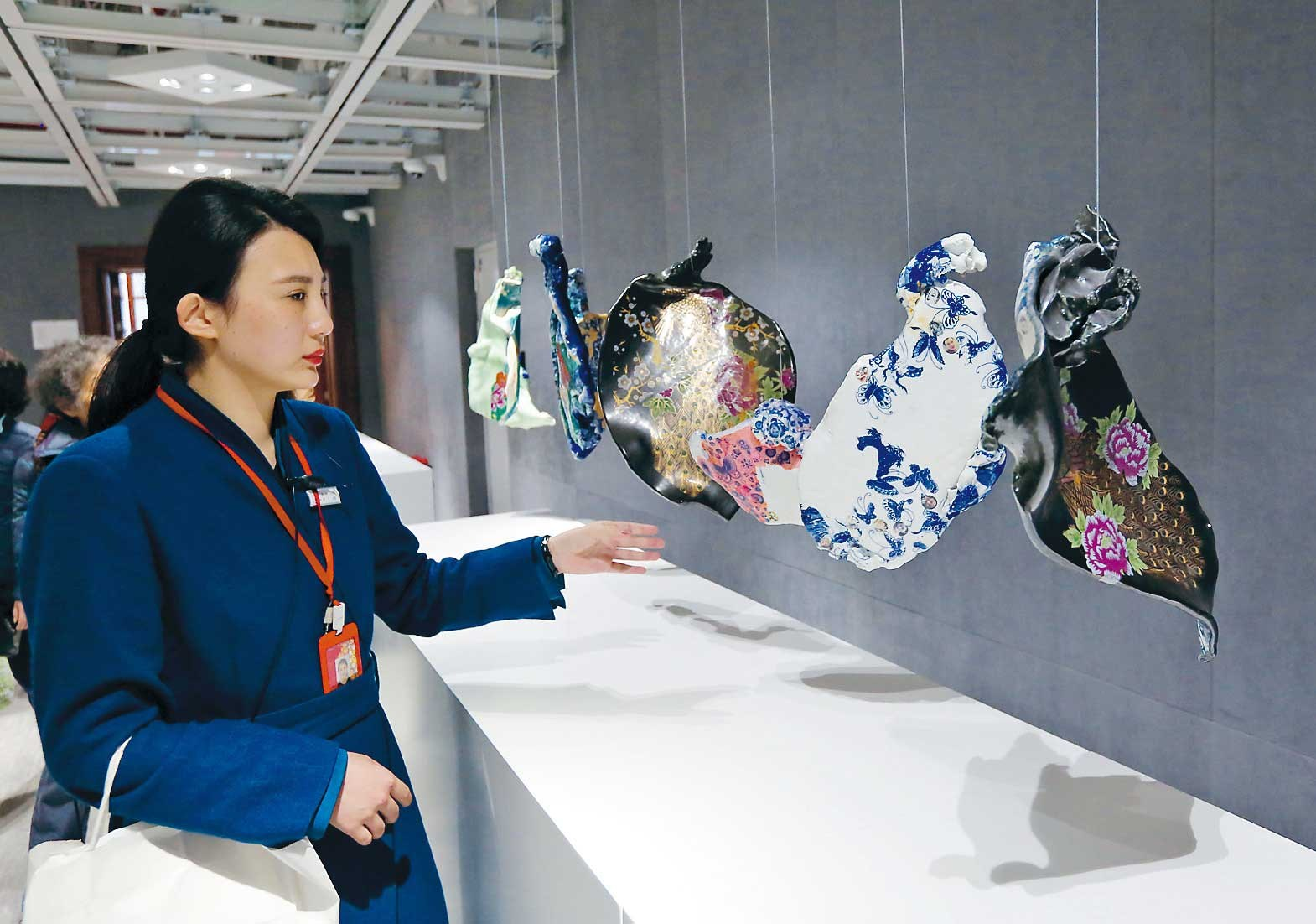 A woman studies exhibits at the Great World Center on downtown Xizang Road during a trial operation yesterday. The renovated exhibition center will open to the public on March 31. Tickets cost 60 yuan (US$8.70). — Wang Rongjiang