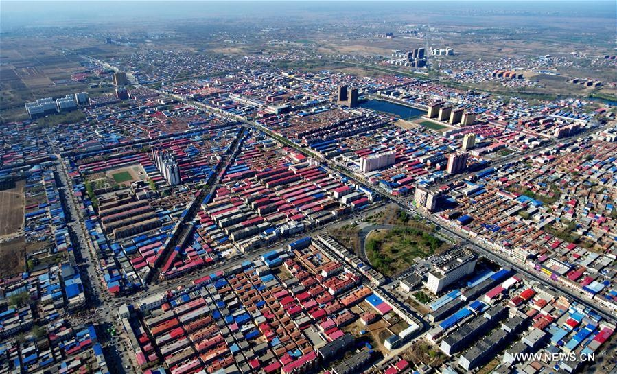 Aerial photo taken on April 1, 2017 shows Xiongxian County, north China\'s Hebei Province. China announced Saturday it would establish the Xiongan New Area in Hebei Province, as part of measures to advance the coordinated development of the Beijing-Tianjin-Hebei (BTH) region. The New Area, about 100 km southwest of downtown Beijing, will span three counties that sit at the center of the triangular area formed by Beijing, Tianjin and Hebei\'s provincial capital Shijiazhuang.