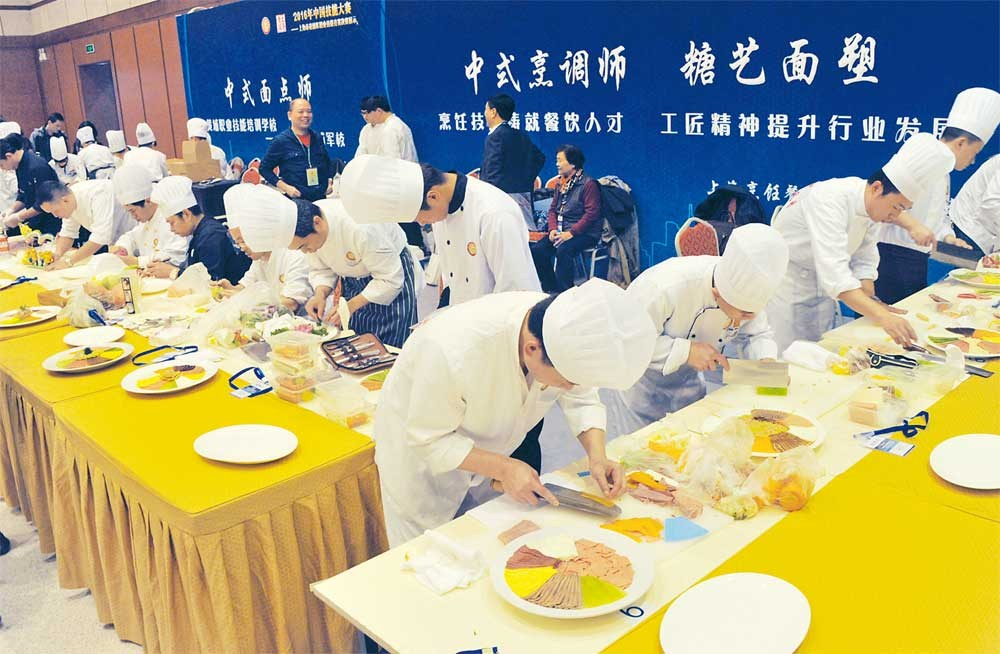 Chefs prepare their dishes at a vocational skill competition in Shanghai. To embed the ideals of skills training in the public mind, the city has created competitions where workers can win awards for the talents they have mastered. — CFP