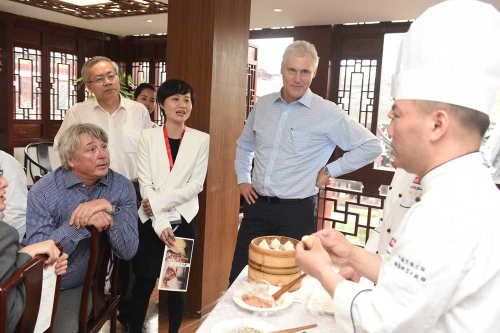 Simon Bartley (left), president of WorldSkills International, and David Hoey, its chief executive, observe a pastry chef at a renowned restaurant in downtown Yuyuan Garden make dumplings. China's Shanghai is competing against Switzerland's Basel to host the 46th WorldSkills competition. — All photographs by Zhang Chi