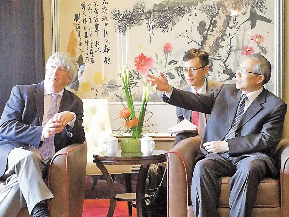 Simon Bartley meets Tang Tao, China's vice-minister of human resources and social security, during his visit to Shanghai