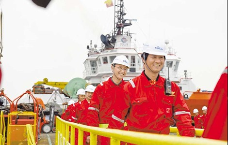 """Crew members from the salvage team on the command ship, """"Dali"""", one of the Chinese vessels that helped to raise the wreck of the sunken South Korean ferry Sewol, return home to Shanghai yesterday. Shanghai Salvage Company won the bid to carry out the salvage operation in July 2015, 15 months after the Korean ferry sank, causing the deaths of 304 passengers. After 590 days of salvage operation, the wreck was lifted on March 22. The company still has several vessels on site to prepare Sewol for being brought ashore."""