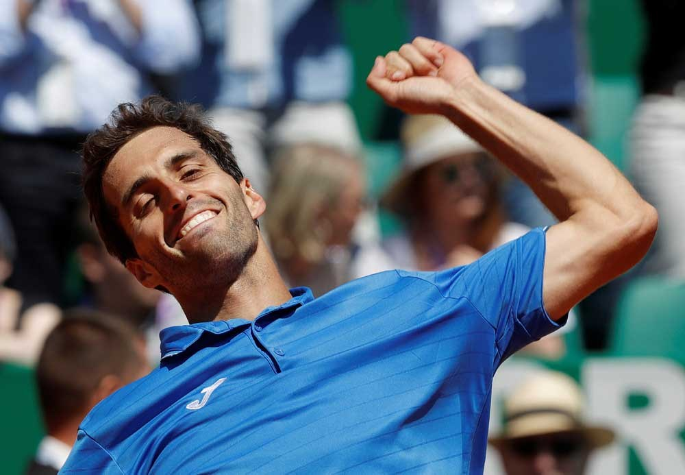 Albert Ramos-Vinolas of Spain reacts after defeating top-ranked Andy Murray of Britain at the Monte Carlo Masters in Monaco yesterday. — Reuters