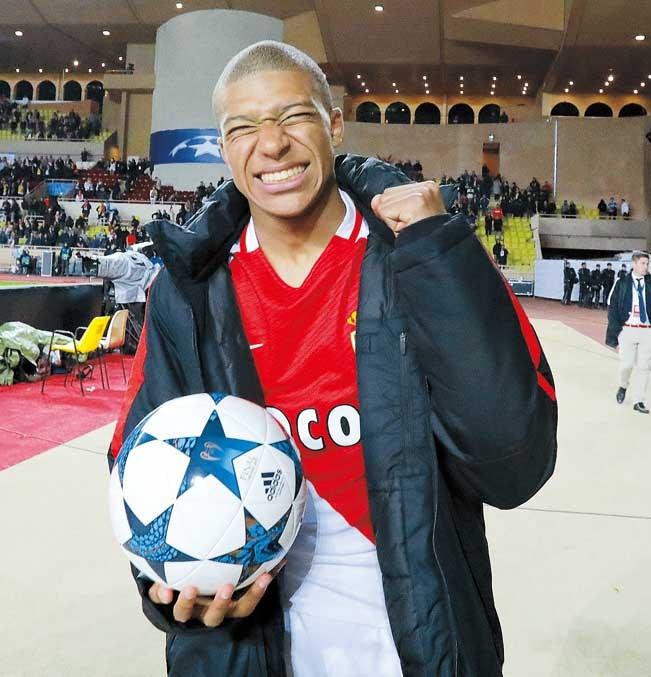 Monaco's Kylian Mbappe-Lottin celebrates after their quarterfinal second leg against Borussia Dortmund at the Stade Louis II in Monaco.