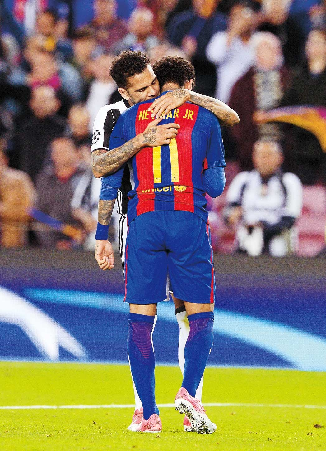 Barcelona's Neymar is comforted by Juventus' Dani Alves after their UEFA Champions League quarterfinal second leg at the Nou Camp in Barcelona on Wednesday.— AFP