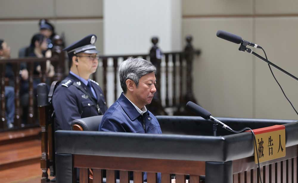 Zhang Yue, a former legal affairs chief in north China's Hebei Province, pictured yesterday during a court hearing in Changzhou in east China's Jiangsu Province. Prosecutors had accused Zhang of taking advantage of his various positions to seek benefits for others and of accepting money and assets worth more than 157 million yuan (US$23 million) between 2008 and 2016. Zhang pleaded guilty to the charges and expressed remorse. A verdict will be announced at a later date. — Xinhua