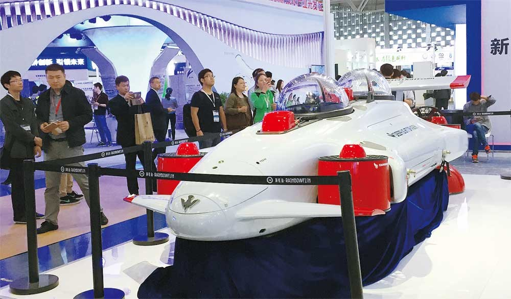 Visitors are attracted by a tourist submarine, which takes passengers to about 100 meters deep in the sea, at the China (Shanghai) International Technology Fair, which opened at the Shanghai World Expo Exhibition and Convention Center yesterday. — Song Yingge