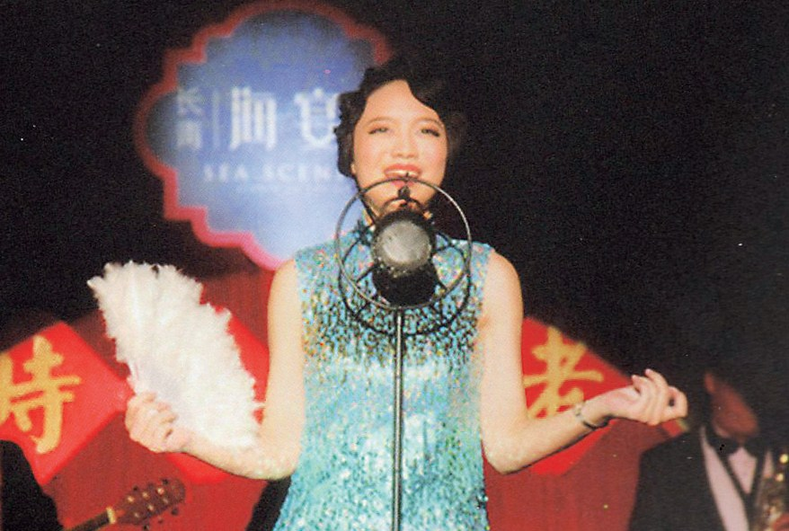 A singer, dressed like an old Shanghai vocalist, performs at the Paramount when it was a nightclub.