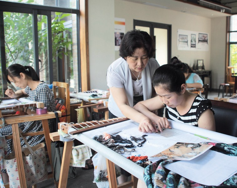 Zhao Hongyu instructs students at her workshop at the foot of Huishan Mountain in west Wuxi, Jiangsu Province.