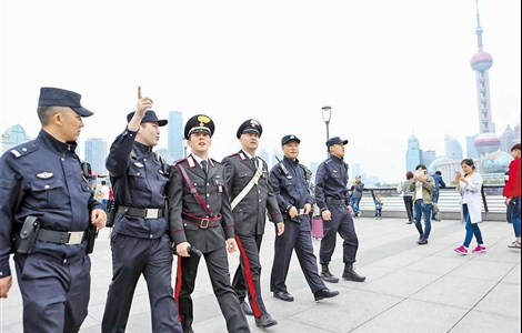 Italian and Chinese officers seen on patrol at the Bund in Shanghai yesterday as part of an exchange program. Their beat covers the Bund, Lujiazui and Yuyuan Garden. The Italian officers have also been on patrol in Beijing. China is sending eight officers to work alongside their Italian counterparts in Rome, Milan, Florence and Naples. A similar program may be launched in conjunction with Austria and Spain later this year, according to China's Ministry of Public Security.