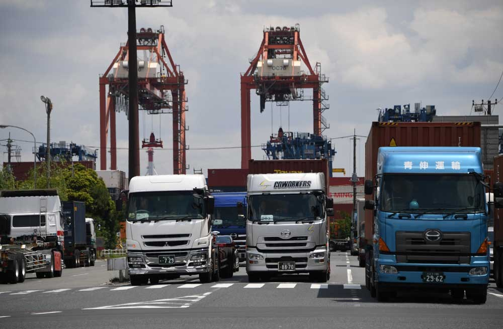 Container trucks jam at Oi container yard of the Tokyo port. Japan has posted its longest economic expansion in over a decade, government data showed yesterday, marking a win for Tokyo's growth bid even though its battle to conquer deflation is still far from won. The world's No. 3 economy grew 0.5 percent in the first quarter — or an annualized 2.2 percent. That was the fifth straight rise and up from a 0.3 percent expansion in the last quarter of 2016. Japan's prospects have been improving on the back of strong exports, with investments linked to the Tokyo 2020 Olympics also giving the economy a shot in the arm. But consumer spending remains tepid and efforts to lift inflation have fallen flat despite years of aggressive monetary easing by Japan's central bank. Private consumption picked up a modest 0.4 percent in the first quarter from zero growth in the previous three months. Individual spending accounts for more than a half of Japan's GDP. — AFP