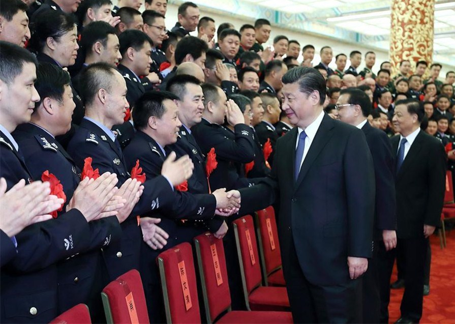 Chinese President Xi Jinping, also general secretary of the Central Committee of the Communist Party of China (CPC), Chinese Premier Li Keqiang and Liu Yunshan, a member of the Standing Committee of the Political Bureau of the CPC Central Committee, meet with heroes and role models from public security departments across the country at the Great Hall of the People in Beijing, capital of China, May 19, 2017. -- Xinhua