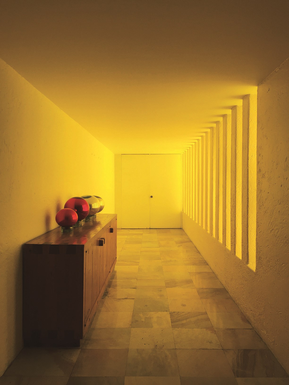 """The yellow colored corridor is the """"altar"""" of the house that leads to the swimming pool."""