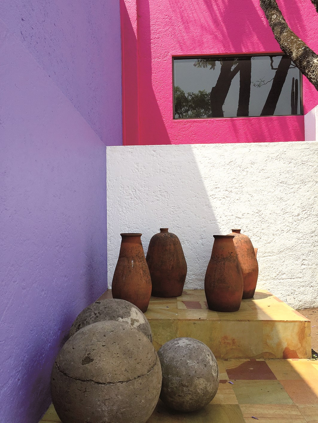 Tequila jars stand prominent in the courtyard