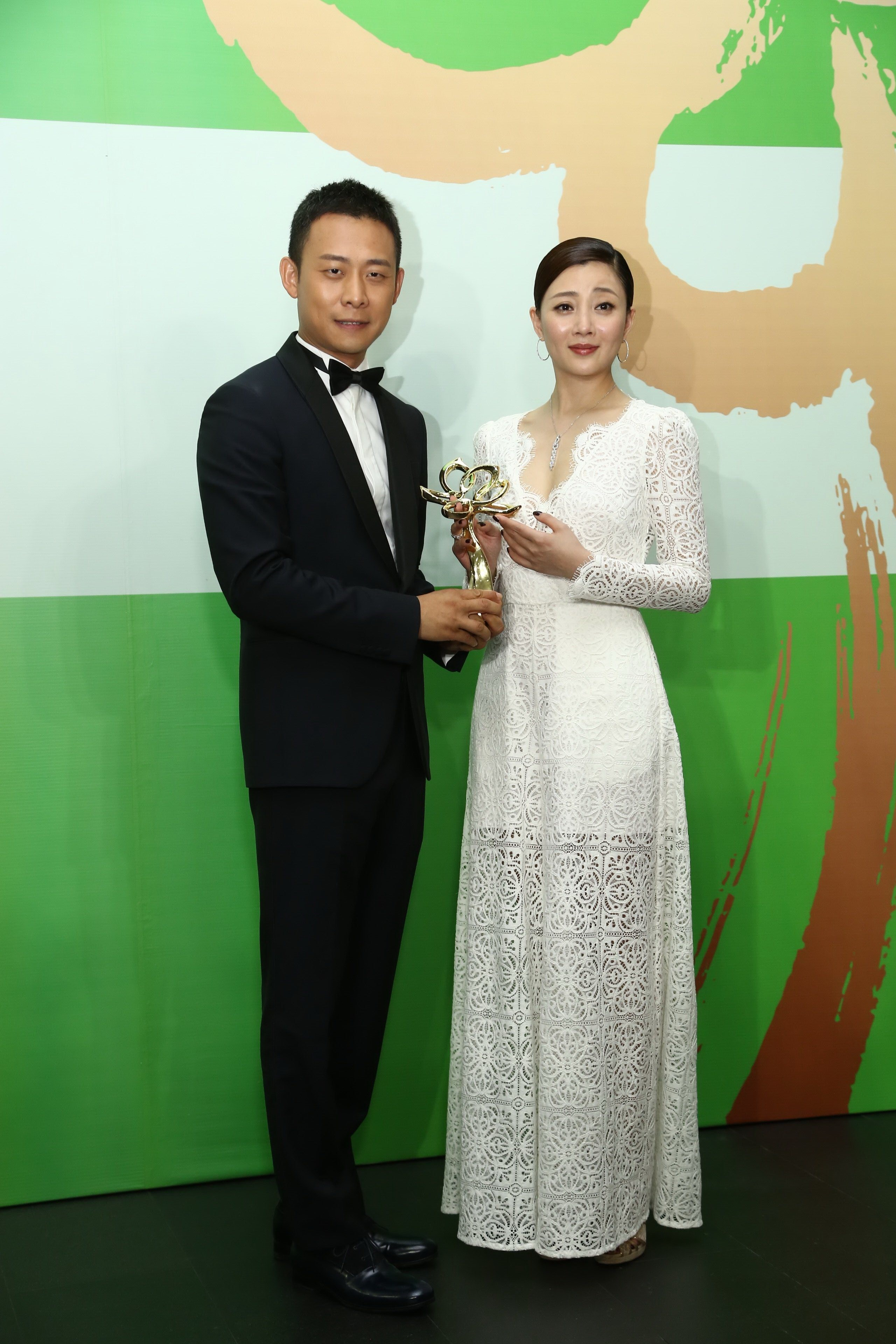 Chinese actress Yin Tao, right, and actor Zhang Yi pose with their trophies after winning the Best Actress and Best Actor awards for their roles in the TV drama