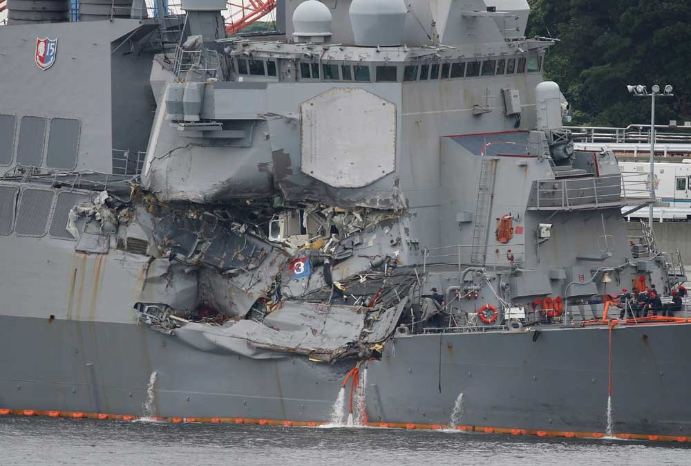 The Arleigh Burke-class guided-missile destroyer USS Fitzgerald, damaged in a collision with a Philippine-flagged merchant vessel, is seen at the US naval base in Yokosuka, Japan. — Reuters