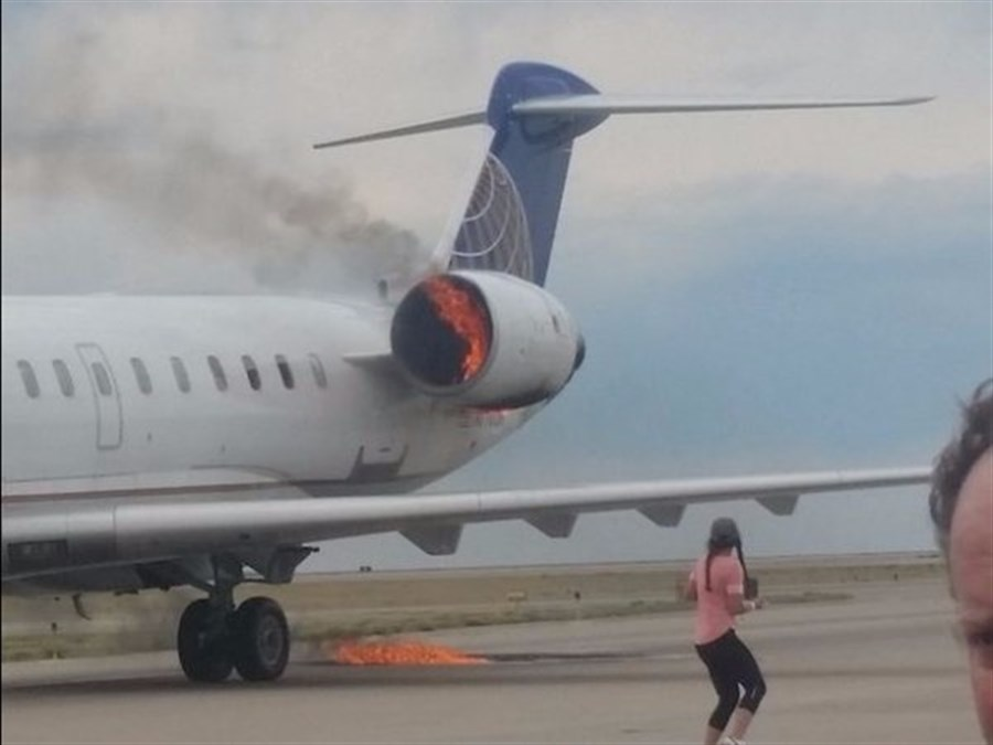 United Airlines' passenger jet catches fire at Denver airport, US