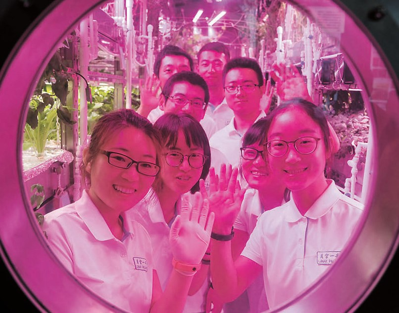 Eight volunteers from two groups are pictured in the sealed, self-contained laboratory Yuegong-1, or Lunar Palace, in Beijing. — Imaginechina