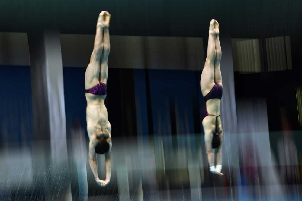 China's Ren Qian and Lian Junjie compete en route to winning the mixed 10-meter synchronized platform final during the diving competition at the FINA world championships in Budapest, Hungary, on Saturday. Xie Siyi and Cao Yuan, however, were denied gold in the men's 3m synchro springboard final as Russia took the title. China was denied a podium in the women's 1m springboard. — AFP