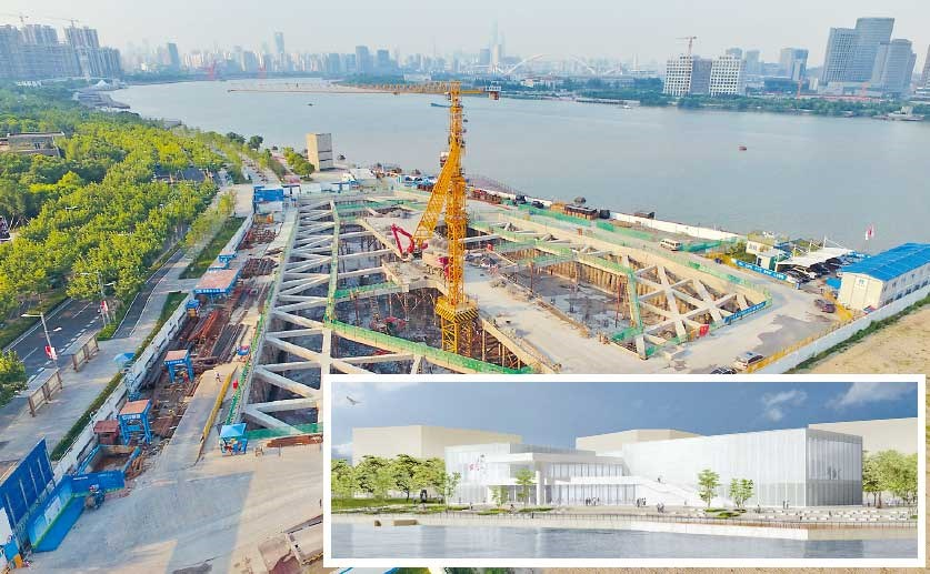 The West Bund Art Museum under construction at the Huangpu River waterfront in Xuhui. Inset: a rendition of how the museum will look. It is scheduled to be finished next year. — Ti Gong
