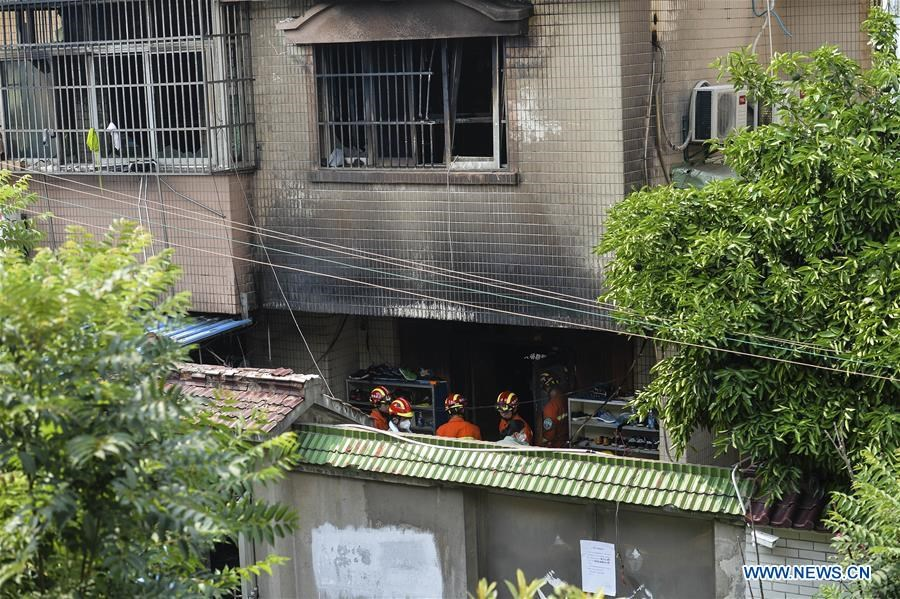 Rescuers work at the site of a house fire in Changshu, east China\'s Jiangsu Province, July 16, 2017. Police in Jiangsu said they have arrested a suspect for alleged arson after a fire engulfed a house that claimed 22 lives Sunday morning.