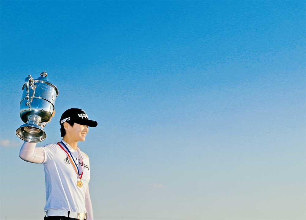 Park Sung-hyun of South Korea poses with the trophy after the final round of the US Women's Open at Trump National Golf Club in Bedminster, New Jersey, on Sunday. — AFP