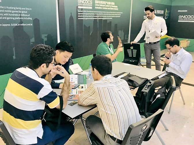 Executives of the Shanghai-based Shinezone attend an industry fair in Tehran, the capital of Iran, to promote its games. Shinezone is among the first Chinese firms to gain a foothold in the mobile games market in Iran. — Gongsi
