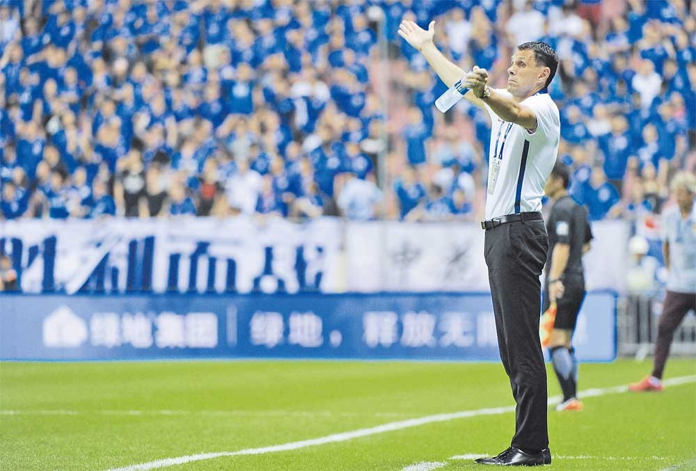 Shanghai Greenland Shenhua head coach Gus Poyet is feeling the heat, with the Uruguayan saying that he has reached his limit following Shenhua's 0-3 home loss to Guizhou on Wednesday. — IC