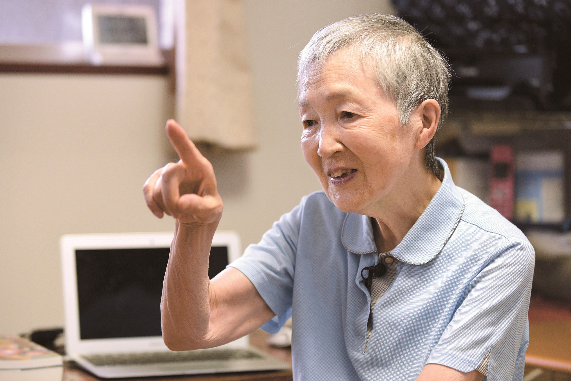 The picture shows 82-year-old Masako Wakamiya talking about the logistics of her pioneering new app which makes android phones more accessible for the elderly. The app has been downloaded 42,000 times since its launch. — AFP