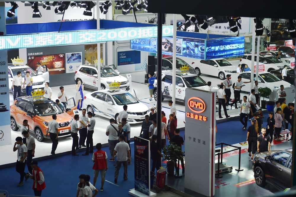 Visitors are seen at the Yinchuan International Auto Show yesterday. The number of new energy vehicles in China has hit 1.01 million, said the Ministry of Public Security yesterday. Electric vehicles made up 825,000, and 193,000 were hybrid electric vehicles, said the ministry. The ministry designated five pilot cities in which 76,000 exclusive green license plates were given for new energy vehicles in 2016. The plates will cover all Chinese cities by the first half of 2018, the ministry said. — Xinhua