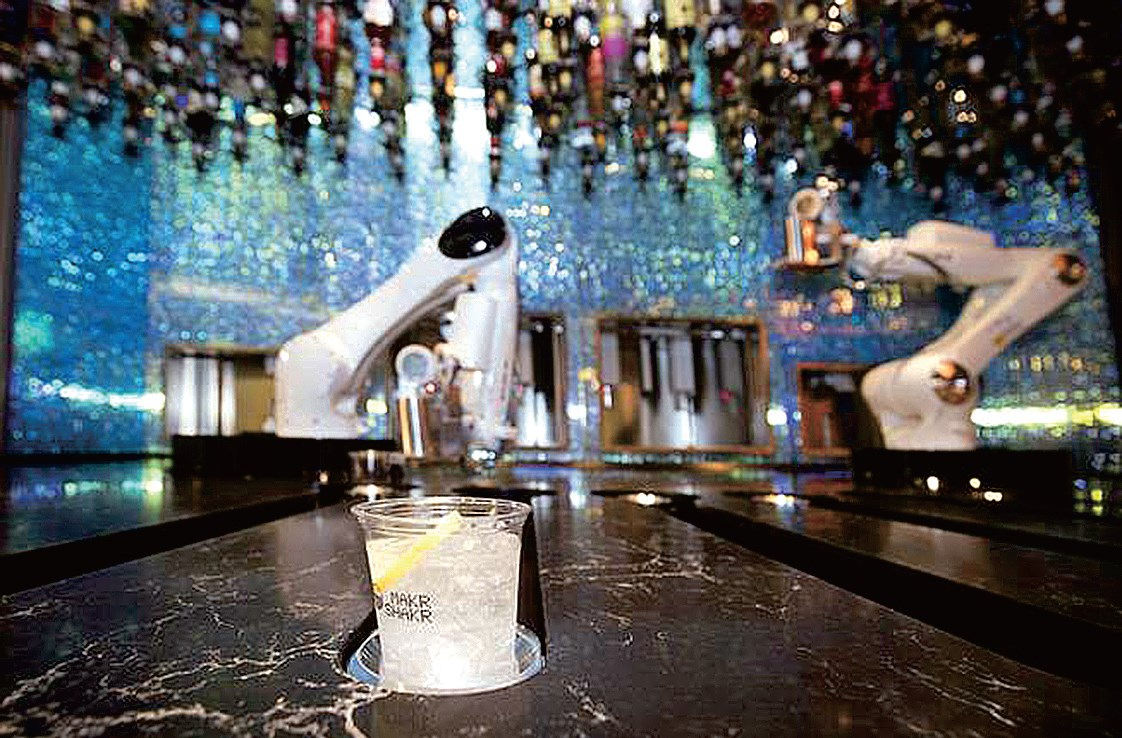 Tipsy, the robot bartender, prepares a drink at a shopping mall bar in Las Vegas. A new wave of automated machines at sports arenas, bars, hotels and other entertainment venues is surging worldwide to provide a futurist experience and save costs.