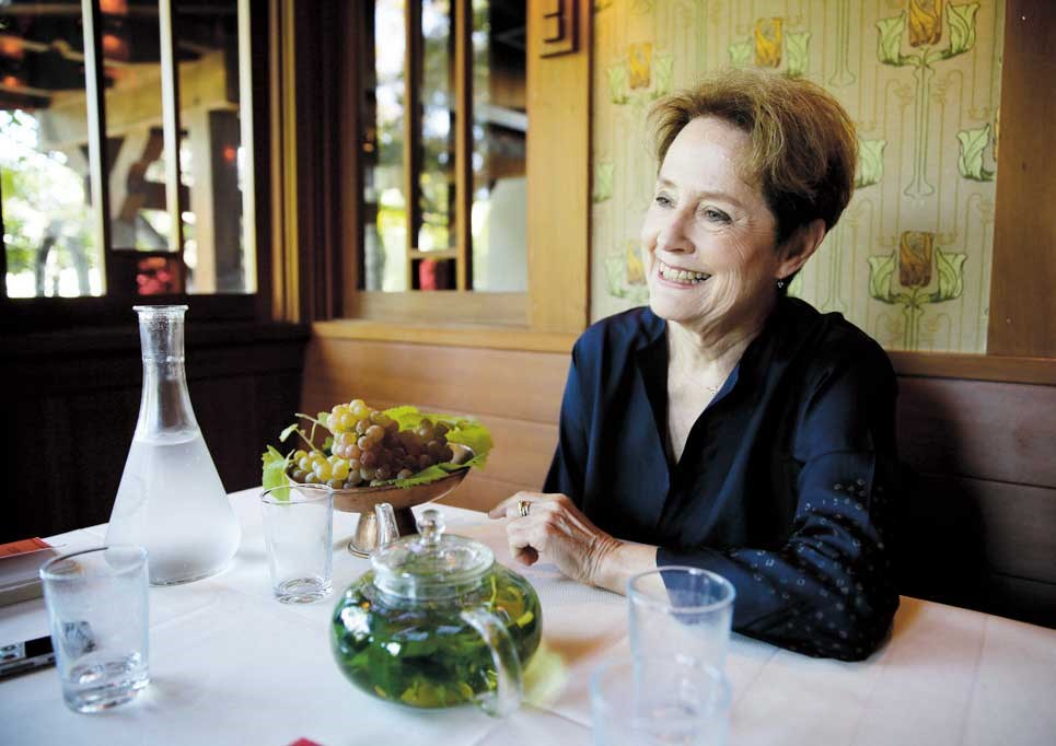 Alice Waters, founder of Chez Panisse restaurant, listens to questions during an interview at the restaurant in Berkeley, California. — IC