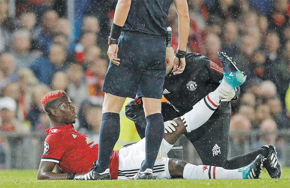 Manchester United's Paul Pogba receives medical attention after sustaining an injury during their UEFA Champions League Group A match against FC Basel at Old Trafford, Manchester, on September 12, 2017. United won 3-0. — Reuters