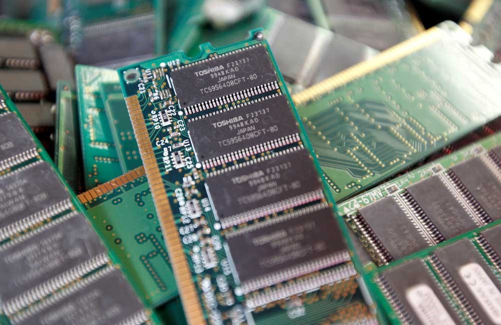 Toshiba's used-memory chips are seen at an electronics shop in Tokyo. Cash-strapped Japanese industrial giant Toshiba said yesterday that it had picked a consortium led by US investor Bain Capital as the leading candidate to buy its prized chip business in a deal reportedly worth some US$18 billion. The development was the latest twist in a long-running saga as Toshiba agonizes between three groups of suitors for its lucrative chip business. The Bain Capital-led group also includes state-backed Development Bank of Japan and the public-private Innovation Network Corp of Japan as well as South Korean chipmaker SK Hynix. — Reuters
