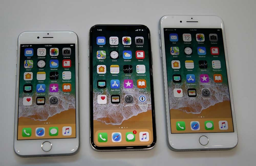 From left: The new iPhone 8, iPhone X and iPhone 8 Plus are displayed during an Apple special event at the Steve Jobs Theater on the Apple Park campus on Tuesday in California. — AFP