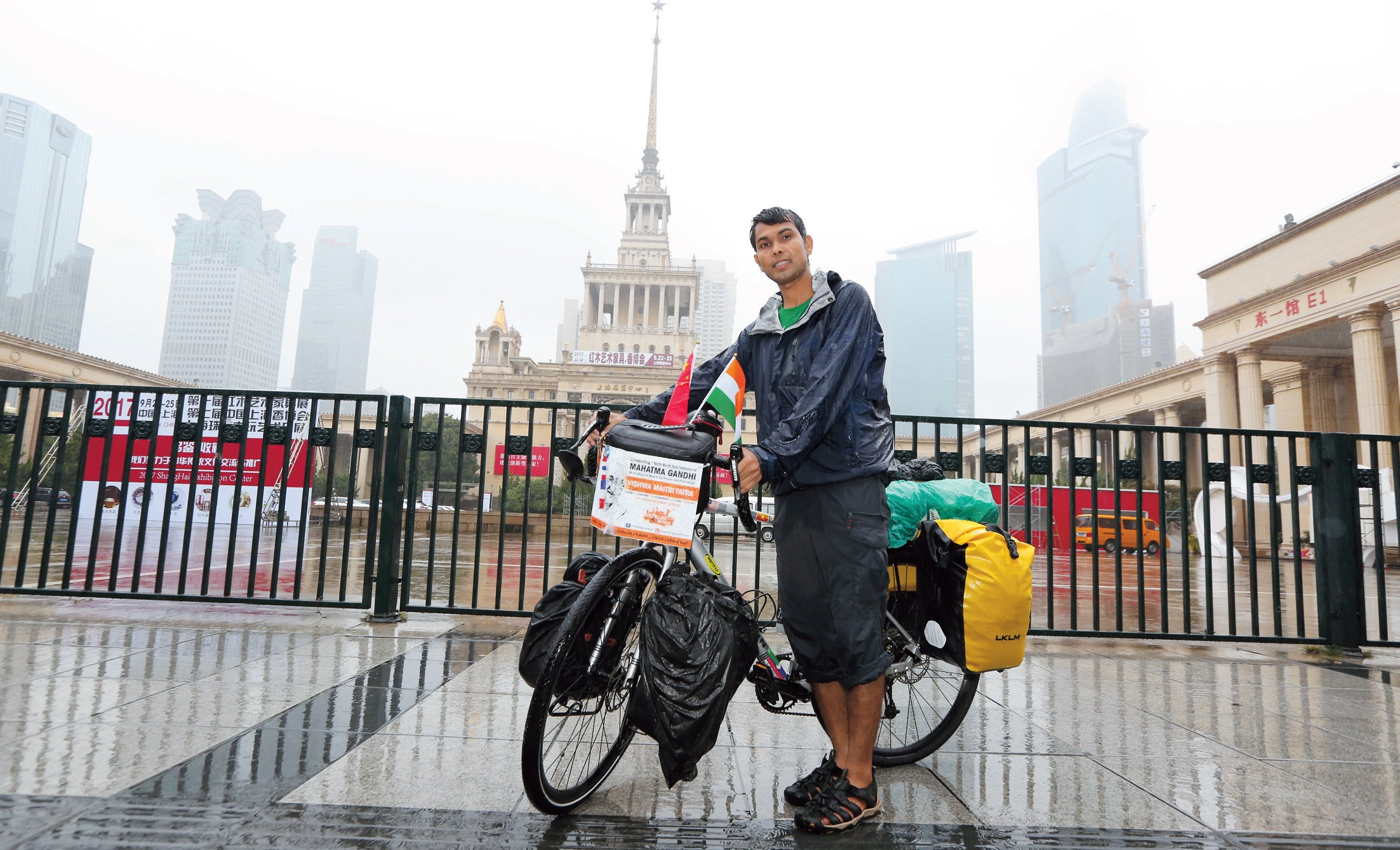 Dnyaneshwar Yeotkar poses in front of the Shanghai Exhibition Center. — Wang Rongjiang
