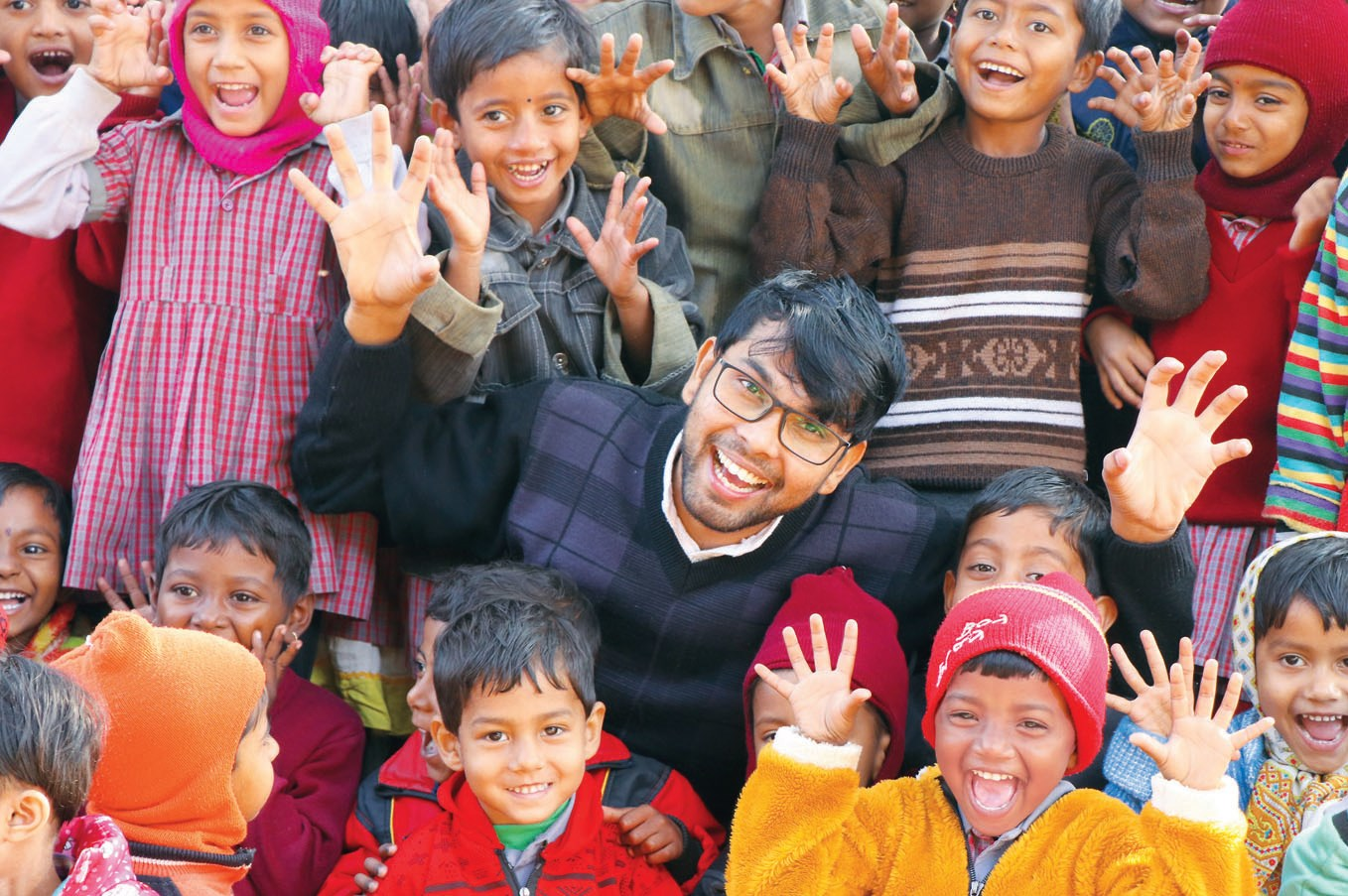 Dnyaneshwar Yeotkar shares a light moment with children in Bolpur, India. On his trips, Yeotkar spends time with children in schools and the sick in hospitals.