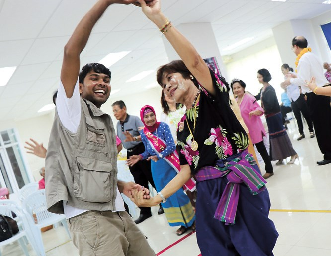 Dnyaneshwar Yeotkar dances with a cancer patient in a hospital outside Bangkok, Thailand.