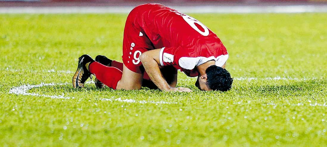 Syria's Omar al-Soma reacts at the end of the World Cup Asian playoff first leg against Australia at Hang Jebat Stadium in Malacca, Malaysia, last night. The match ended 1-1. — Reuters