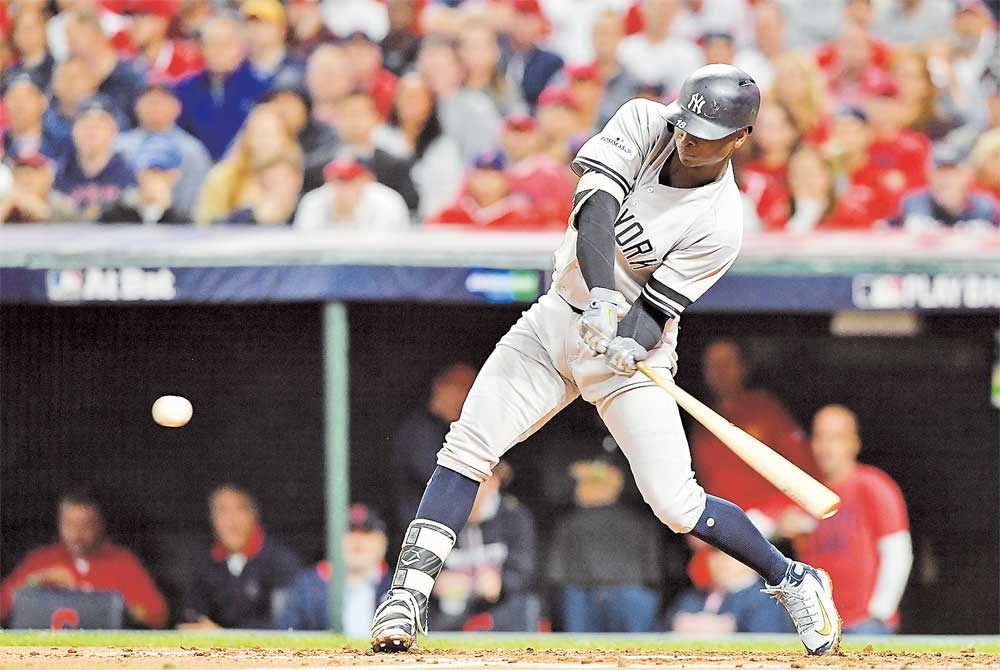 Didi Gregorius of the New York Yankees hits a two-run home run in the third inning against the Cleveland Indians in Game 5 of their American League Division Series at Progressive Field in Cleveland, Ohio, on Wednesday. The Yankees won 5-2 to advance to the AL Championship Series against the Astros, with Game 1 on Saturday in Houston. Elsewhere, the Washington Nationals staved off elimination by beating the Chicago Cubs 5-0 in Game 4 of their National League DS. Game 5 is today in Washington, with the winner taking on the Los Angeles Dodgers. — AFP
