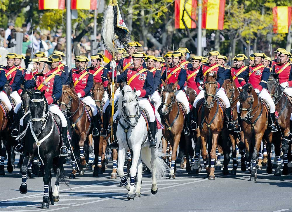 Spanish Guardia Civil honor troops march during the Spanish National Day military parade in Madrid yesterday. The day was overshadowed by a push for independence for Catalonia. — AFP