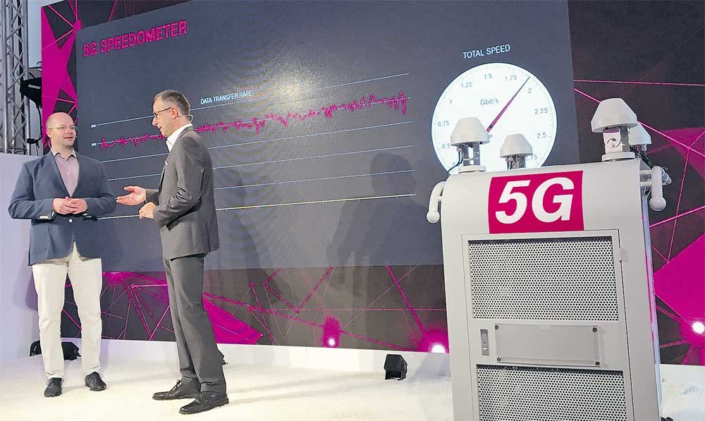 Deutsche Telekom CTO Bruno Jacobfeuerborn (right) presents 5G ultra high-speed next generation mobile antennas technology in Berlin yesterday, a milestone in the race to provide the fast response times needed for virtual reality and autonomous driving. Telekom said it was the first use of the technology in a real world setting in Europe. — Reuters