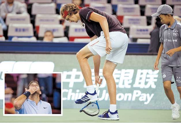 Alexander Zverev of Germany breaks his racquet during the Shanghai Rolex Masters third-round match against Juan Martin del Potro (inset) of Argentina at the Qizhong Tennis Center in suburban Minhang District yesterday. The third seed lost 6-3, 6-7 (5), 4-6. — AFP