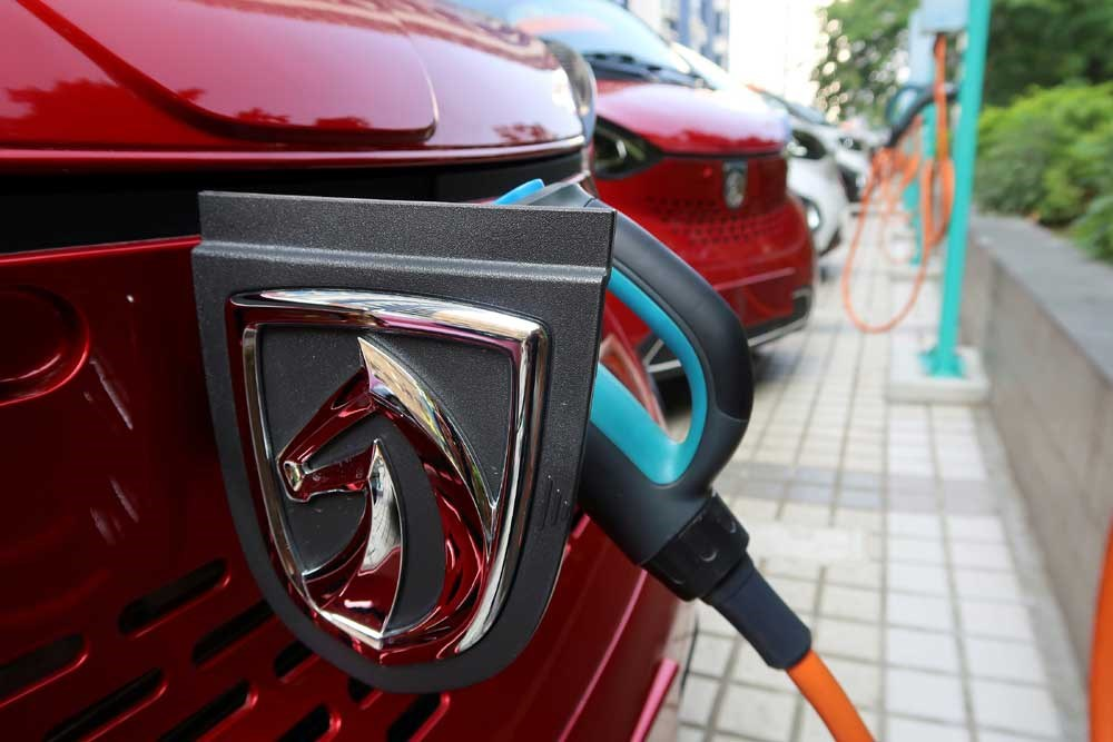 A Baojun E100 all-electric battery car is seen while it is being charged in a Baojun NEV Experience Center in Liuzhou, Guangxi Zhuang Autonomous Region in this file photo. — Reuters