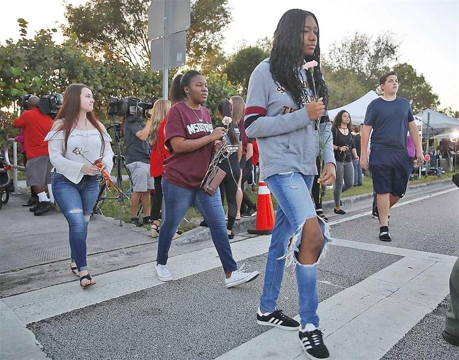 Students in emotional return to shooting-hit high school